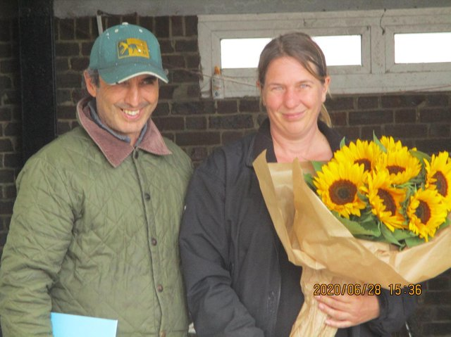 Suzy Smith and Sergio Gordon-Watson with flowers presented by the Lewes Racecourse History Group
