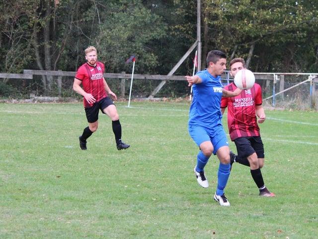 Action between AFC Uckfield and Horsham YMCA / Picture: Tim Hewlett