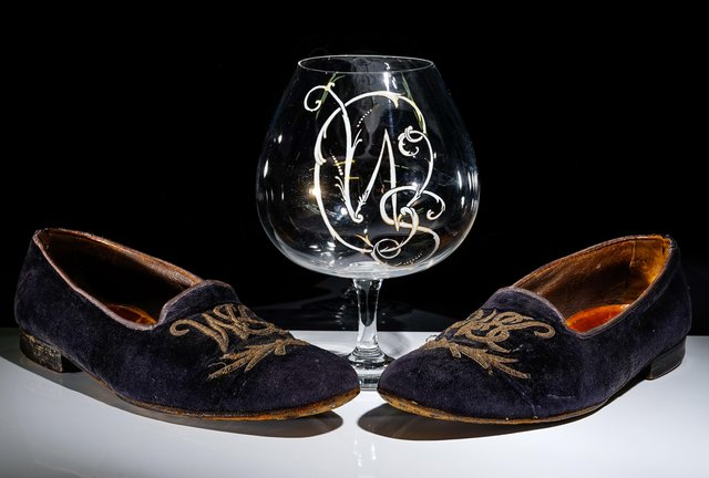 A pair of slippers and brandy glass belonging to Winston Churchill were sold by a Wisborough Green auction house