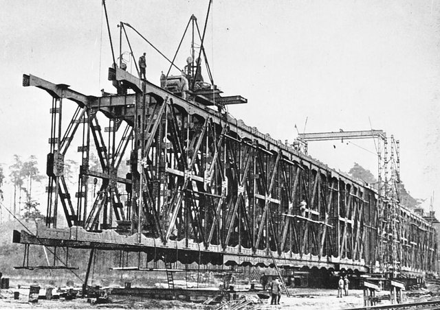 A sectional truss bridge, constructed by the cantilever method