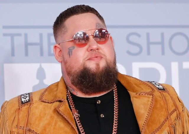 Rag'n'Bone Man poses on the red carpet on arrival for the BRIT Awards 2020 in London on February 18, 2020. Photo by Tolga AKMEN via Getty Images
