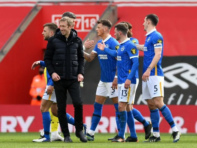 Graham Potter congratulates his players after victory at Southampton