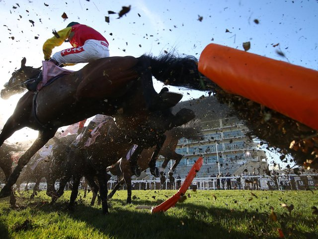 Zoffanien ridden by Richard Johnson jumps a hurdle first time round during the Boodles Juvenile Handicap Hurdle (Grade 3) on Day One of the Cheltenham Festival  (Photo by Michael Steele/Getty Images)