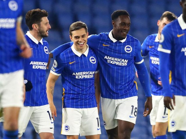 Leo Trossard and Danny Welbeck celebrate at the Amex Stadium against Newcastle