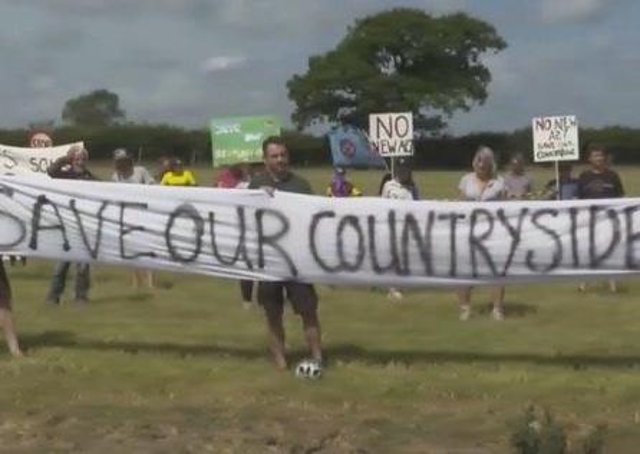 Campaigners during a socially-distanced protest last summer