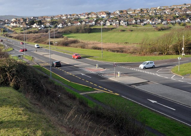 Traffic on the A259 Buckle By-Pass where it becomes Newhaven Road with Hill Rise and Marine Parade joining it and Bishopstone Road in the distance also joining.