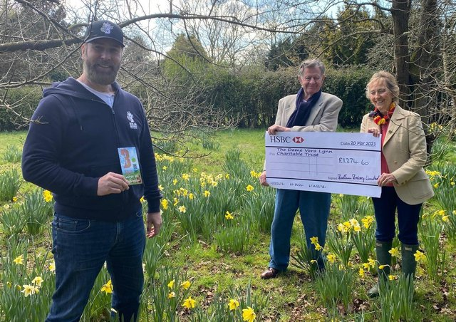 Danny Hoskins, sales director of Bedlam Brewery, presented a cheque for £1,274 to Dame Vera's daughter Virginia Lewis-Jones and son-in-law Tom on Saturday, March 20. Picture: Bedlam Brewery