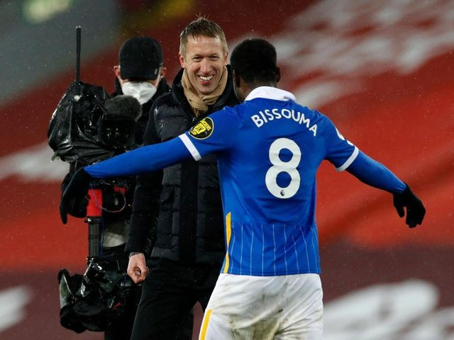 Yves Bissouma celebrates victory at Liverpool with Brighton head coach Graham Potter