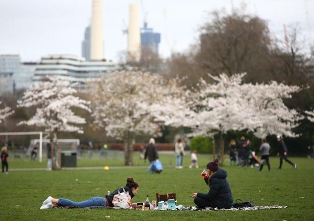 Two households with up to six people can now meet outdoors, as lockdown restrictions are relaxed in England (Photo by Hollie Adams/Getty Images) SUS-210329-152004001