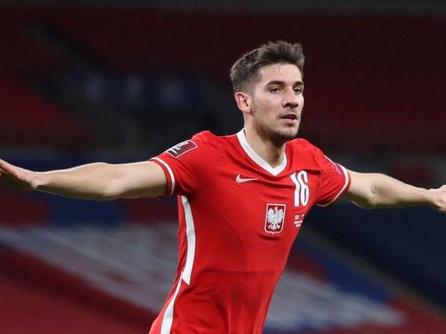 Brighton's Poland international Jakub Moder celebrates his strike against England at Wembley on Wednesday night