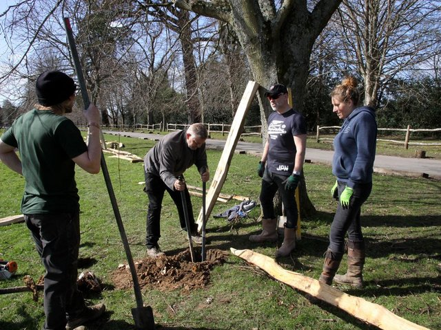 Volunteers at Buxted Park work on the ground's boundary fence / Picture: Ron Hill