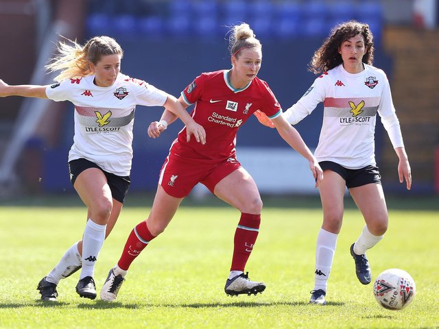 Rhiannon Roberts of Liverpool battles for possession with Filippa Savva and Lucy Ashworth-Clifford of Lewes / Picture: Getty