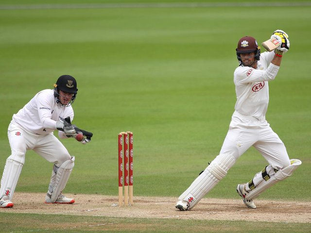 Ben Brown behind the stumps as Ben Foakes hits out / Picture: Getty