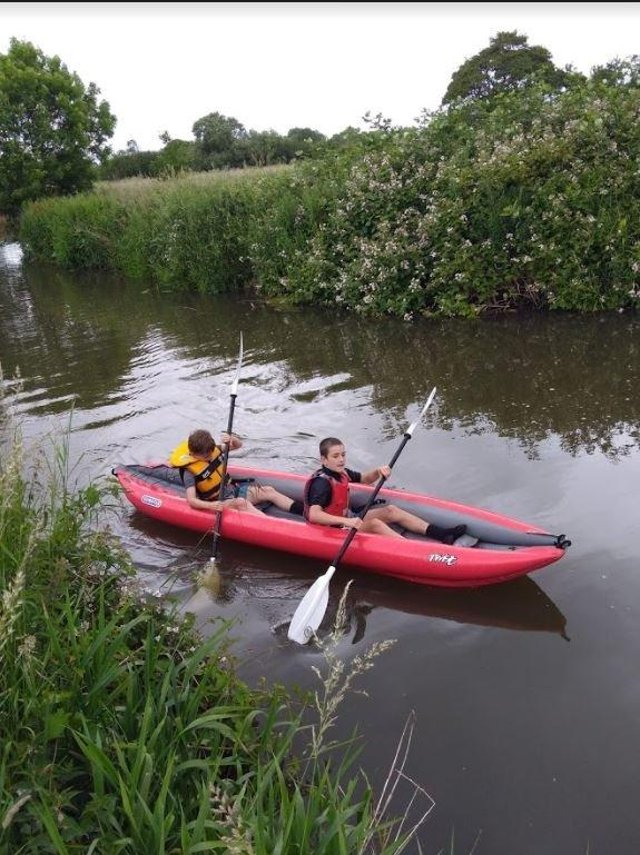 TJ and Tommy Schofield kayaking at Barcombe Mills last year