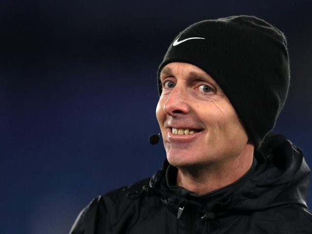 Mike Dean waved away penalty appeals for Brighton at Old Trafford