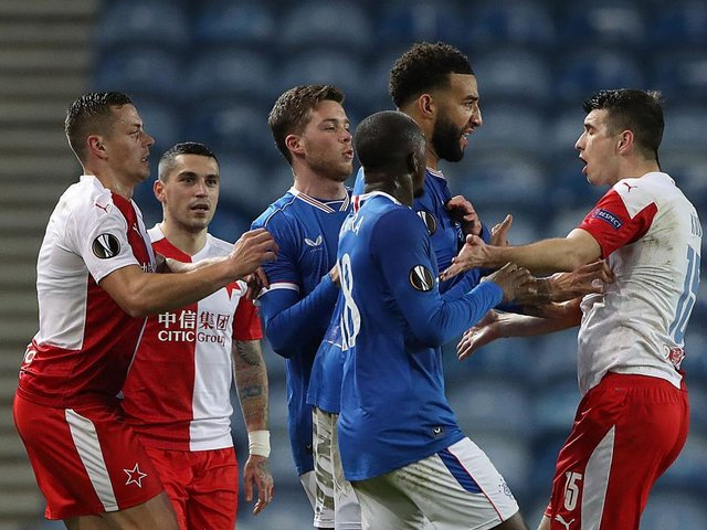 Rangers players clash with Ondrej Kudela of Slavia Prague during the UEFA Europa League Round of 16 Second Leg match at Ibrox