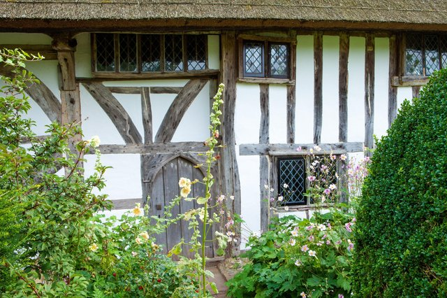 The half-timbered exterior wall of Alfriston Clergy House, East Sussex. A rare 14th-century Wealden hall-house set in a traditional garden. National Trust Images_Marianne Majerus SUS-190710-123835001