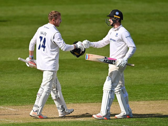 Stiian van Zyl is congratulated on his ton by George Garton as Sussex build a big lead / Picture: Getty