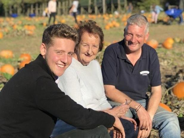 Stuart Beare, right, with his son Sam and mother Marion at Tulleys Farm, during a Pick Your Own Pumpkin event