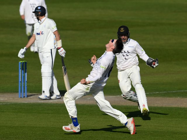 Jack Carson can't hide his delight at removing Joe Root / Picture: Getty