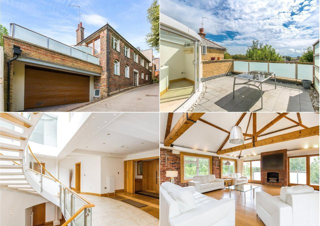 This modern house with office, cinema bar and two roof terraces, is on the market for £1,650,000