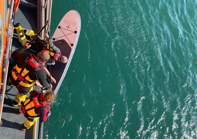Bringing the paddle board in. Photo: RNLI/Rob 'Archie' Archibald