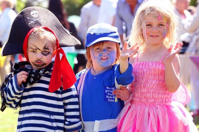 HOR020511 Maypole Fair on Plaistow Village Green. Fancy dress competition. L to R Daniel Simpson aged 3, 1st, Austin Johnson aged 3 2nd and Matilda Simpson aged 4 3rd. photo by derek martin ENGSNL00120110205170447