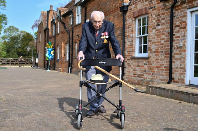 Captain Sir Tom Moore completed 100 laps of his garden April 16. (Photo by JUSTIN TALLIS/AFP via Getty Images) PPP-210427-141307003