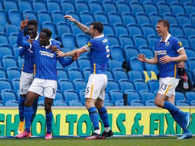 Brighton players celebrate a vital victory against Leeds United at the Amex Stadium