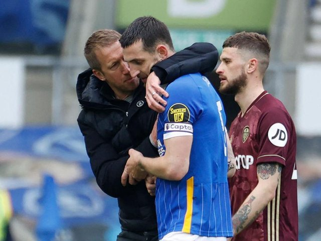 Graham Potter congratulates Lewis Dunk after his performance against Leeds United at the Amex Stadium on Saturday