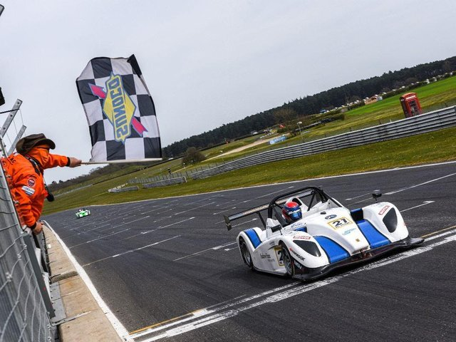 Will Hunt takes the chequered flag / Picture: Ollie Read Photography
