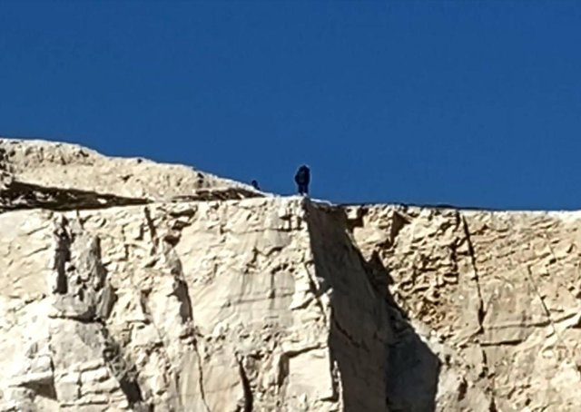 A still image of the man at the cliff edge - taken from the video by Paul Burns