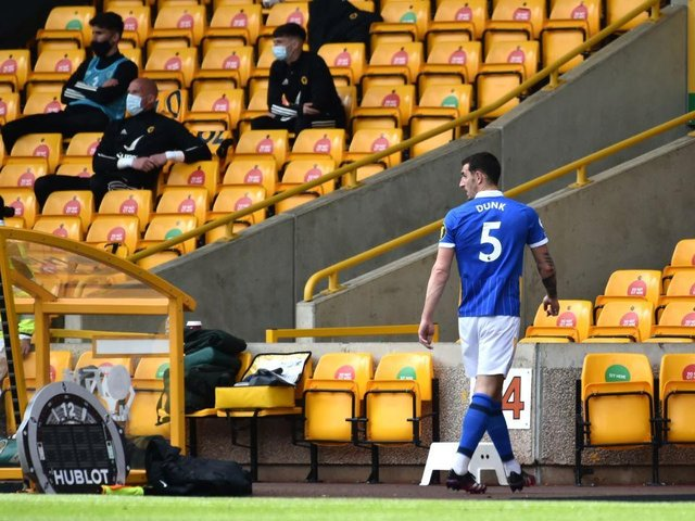 Lewis Dunk trudges off after his red card against Wolves
