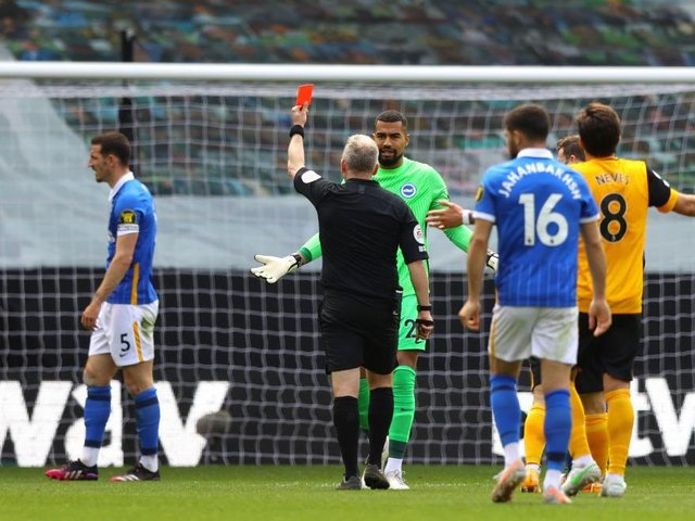 Lewis Dunk received a red card during the second half at Wolves