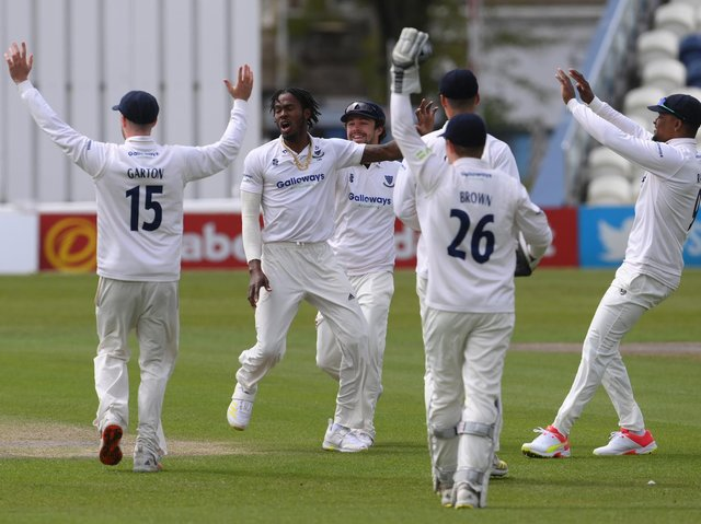 Jofra Archer celebrates with his Sussex teammates after dismissing Zak Crawley on day one of Kent's visit to Hove / Picture: Getty