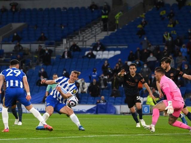 Dan Burn fires home the winner for Brighton against Man City at the Amex Stadium
