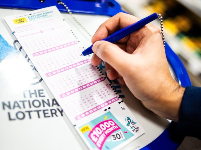 National Lottery slip. SUS-210428-100202001