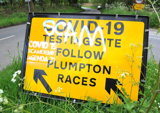 Graffiti on a yellow directions sign on North Common Road at the junction of Plumpton Road, near Plumpton and Wivelsfield Green. Picture: Steve Robards, SR2105273