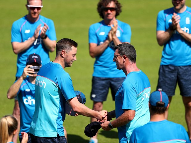 Ollie Robinson is handed his cap by Jon Lewis / Picture: Getty