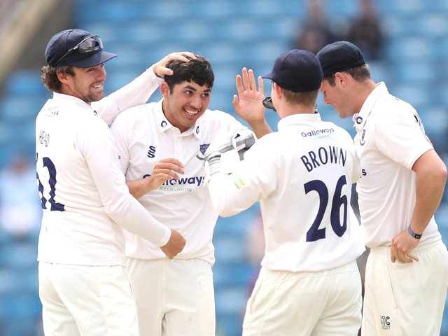 Dan Ibrahim is congratulated on a wicket - that after making history as the youngest  half-century maker the county championship has ever seen / Picture: Getty