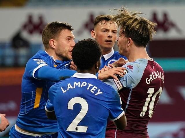Brighton defender Joel Veltman (left) gets to grips with Aston Villa's Jack Grealish
