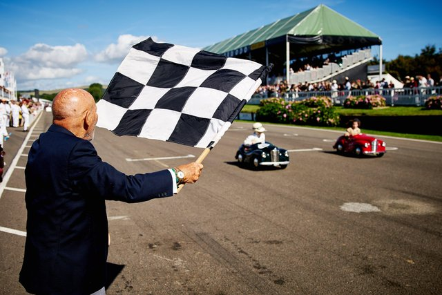 A tribute to Sir Stirling Moss (pictured waving the chequered flag in 2016) will take place at this year's Revival - Photo by Dominic James