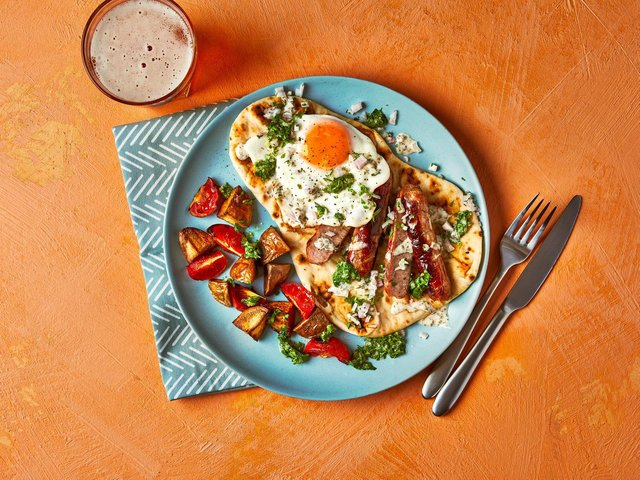 Loaded sausage and egg naan with coriander chutney from Gousto