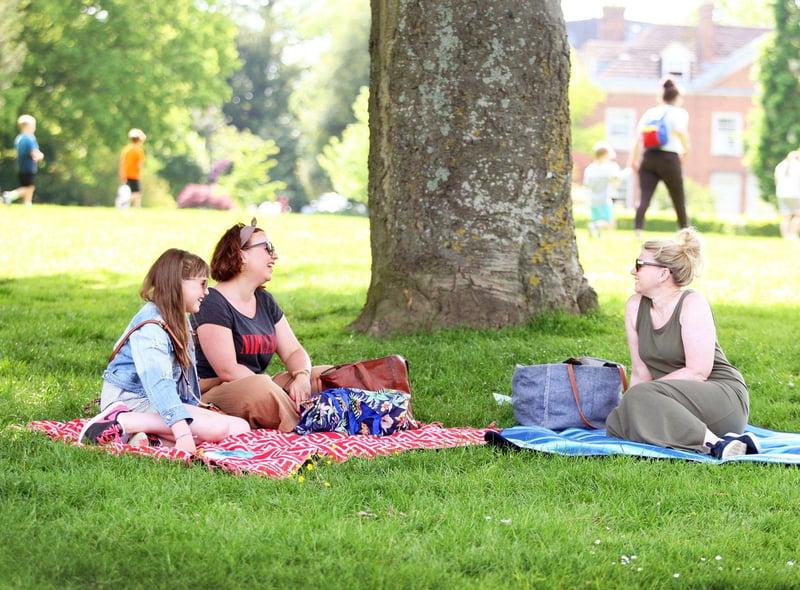 People enjoying sunny weather in Horsham Park. Photo by Derek Martin Photography. SUS-210206-154406008