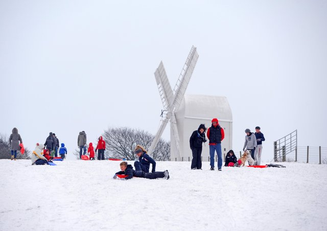 Children have fun playing in the snow near Jack and Jill windmills in January 2013. Photo by Derek Martin.