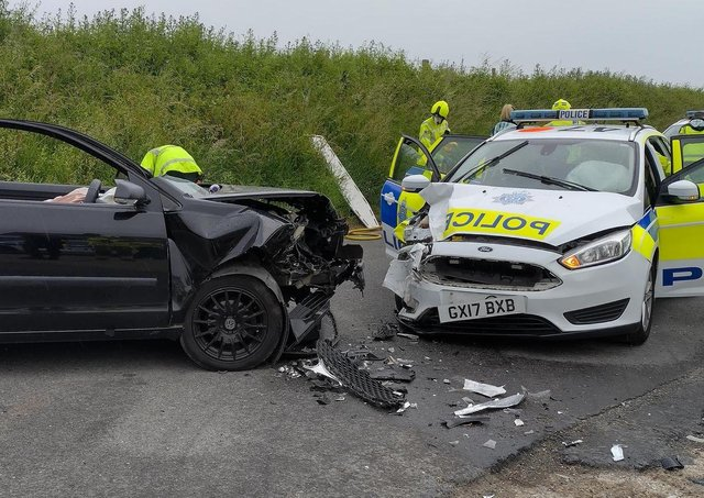 A police car was involved in a collision with a vehicle 'being driven by someone leaving the event'. Photo: Eddie Mitchell