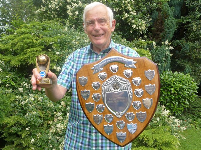 Phil with his shield and trophy, awarded for his work on telling the story of Albion legend Tommy Cook