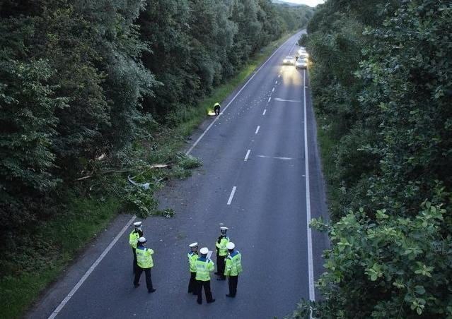 Police at the scene of the crash on July 9. SUS-210715-121331001